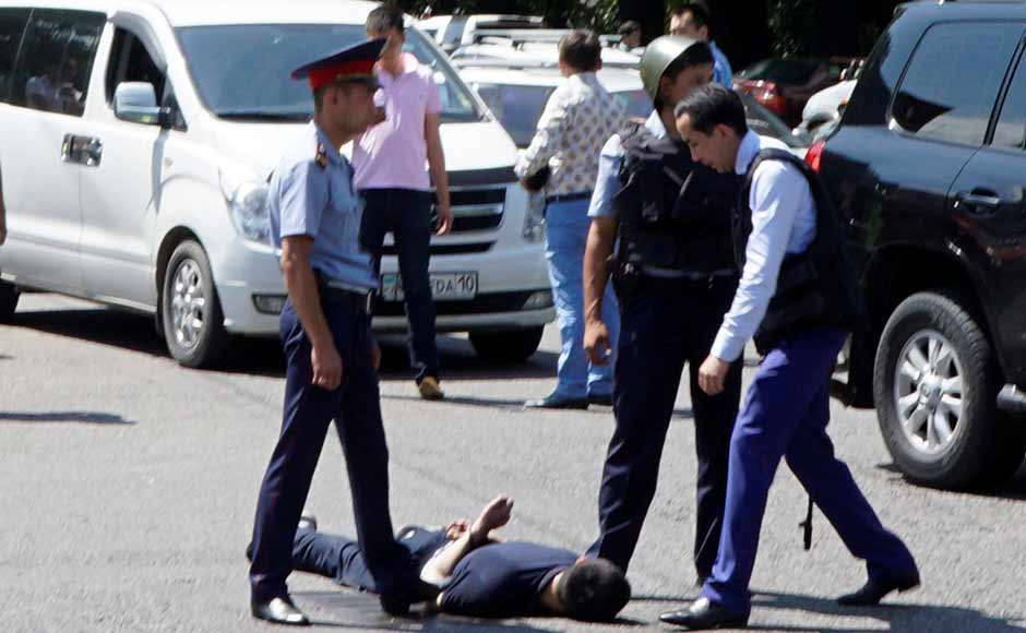 Police officers detain a man after an attack in the centre of Almaty. The police said it has detained one suspect, identified as a 27-year-old former convict who was wanted for the murder of a woman. The other man remained at large. Reuters
