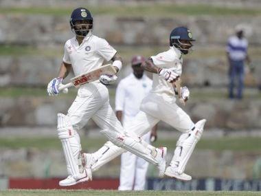 India's captain Virat Kohli and teammate Shikhar Dhawan. AP