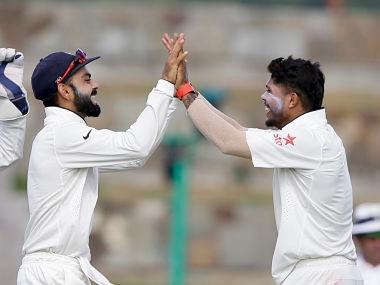 File picture of Virat Kohli (L) and Umesh Yadav. AP