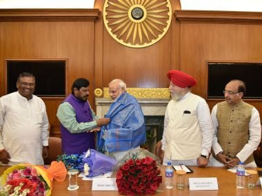 Prime Minister Narendra Modi with his newly-inducted cabinet of ministers. PIB