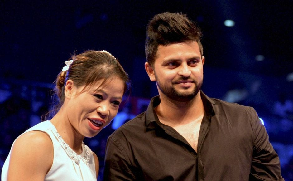 New Delhi: Boxer Mary Kom and Cricketer Suresh Raina before the WBO Asia Pacific Middleweight Championship at Thyagaraj Sports Complex in New Delhi on Saturday.PTI Photo by Manvender Vashist(PTI7_16_2016_000206B)
