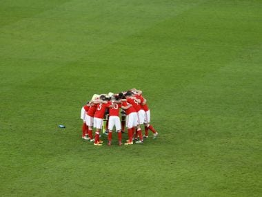 Wales' players embrace before the match. Reuters