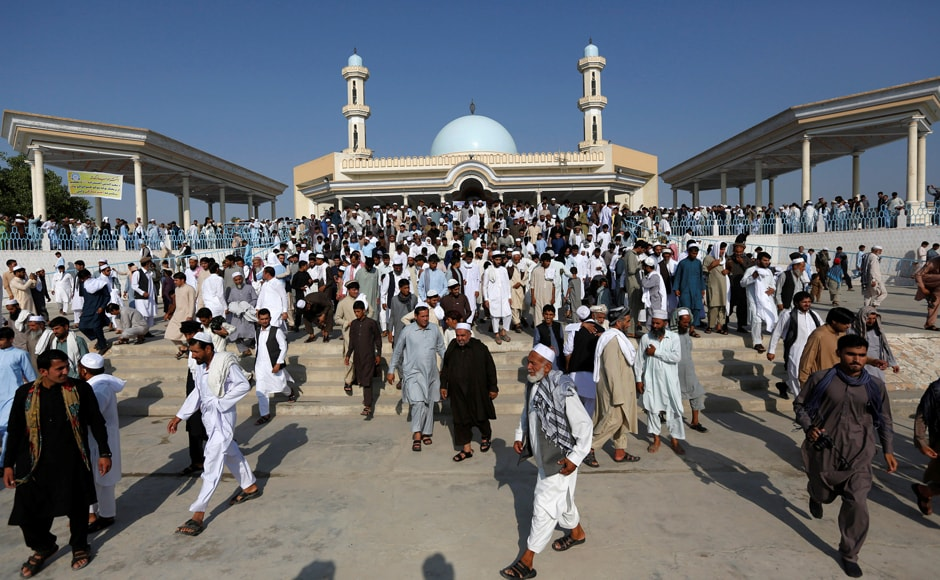Men leave after attending morning prayers to celebrate the first day of the Muslim holiday of Eid al-Fitr, which marks the end of the holy month of Ramadan, in Jalalabad, Afghanistan. Reuters