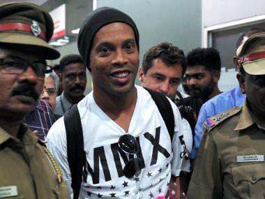 Brazilian fottballer Ronaldinho arrives in Chennai for Premier Futsal. AFP