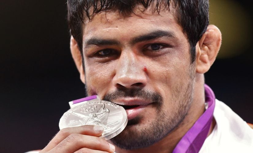 Sushil Kumar with his silver medal at the London Olympics. Reuters