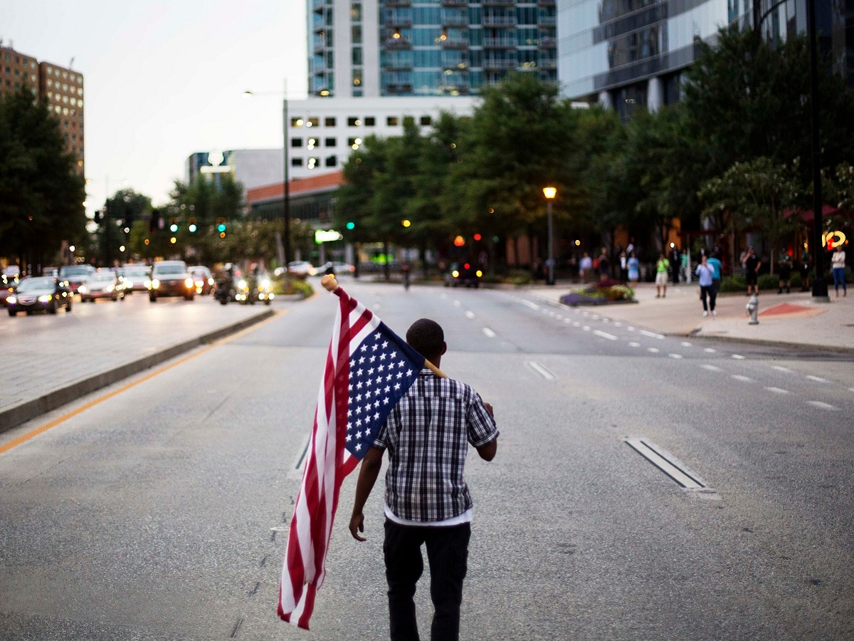 Protesters held rallies in several US cities to protest police shootings of African-Americans. AP