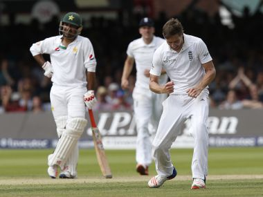 England's Chris Woakes celebrates taking a wicket on Day 3. AFP
