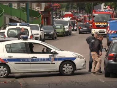 Police investigate the site of attack. AP