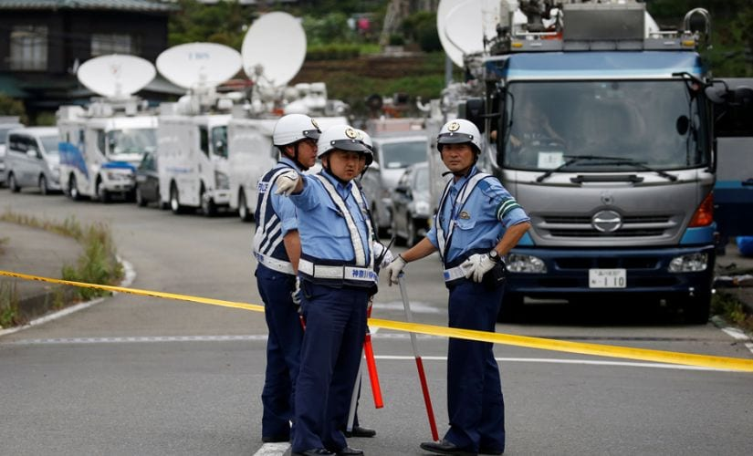 Police officers stand guard at a facility for the disabled, where a deadly attack by a knife-wielding man took place, in Sagamihara, Kanagawa prefecture in Japan. Reuters