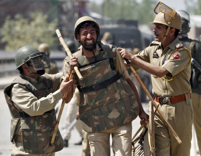 A file image of a police personnel injured during clashes with mob in Srinagar. Reuters