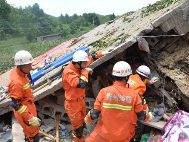 Rescue workers carry out a search at the site of a landslide in Bijie, Guizhou province in southwest China. Reuters