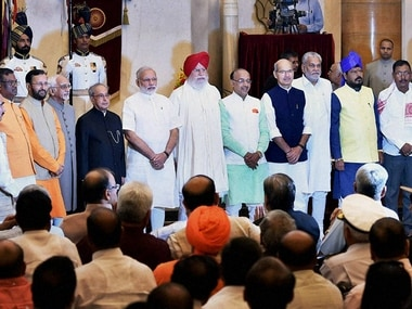 PM Modi with the council of ministers. PTI