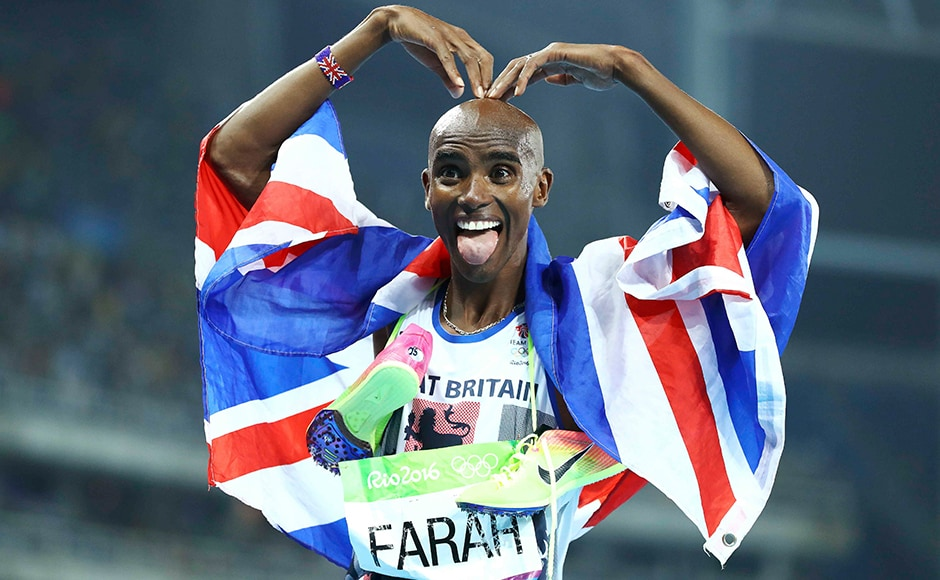 2016 Rio Olympics - Athletics - Final - Men's 5000m Final - Olympic Stadium - Rio de Janeiro, Brazil - 20/08/2016. Mo Farah (GBR) of Britain poses after winning the gold. REUTERS