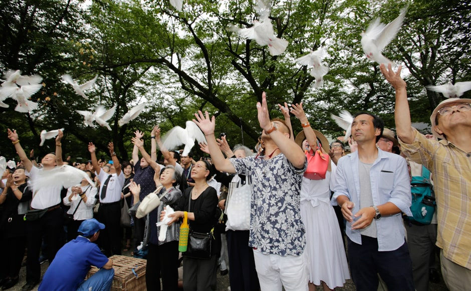 Local officials and those who survived the bombing called for strict adherence to Japan's post-war tradition of pacifism. Worshippers at the shrine released doves, wishing for the world peace. Photo: AP