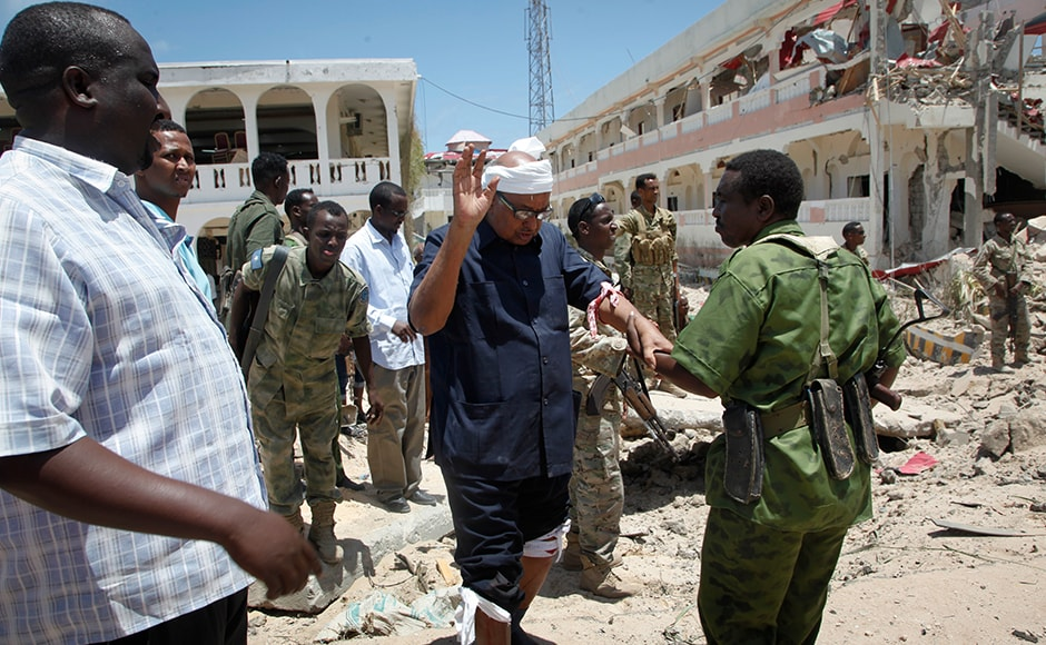 A soldier helps Somali lawmaker Abdalla Bos Ahmed, center, after he was injured by a blast near the presidential palace in the capital Mogadishu which was claimed by an insurgent group al-Shabab. While al-Shabab has been ousted from most of Somalia's cities, it continues to carry out bombings and suicide attacks, notably in the capital.