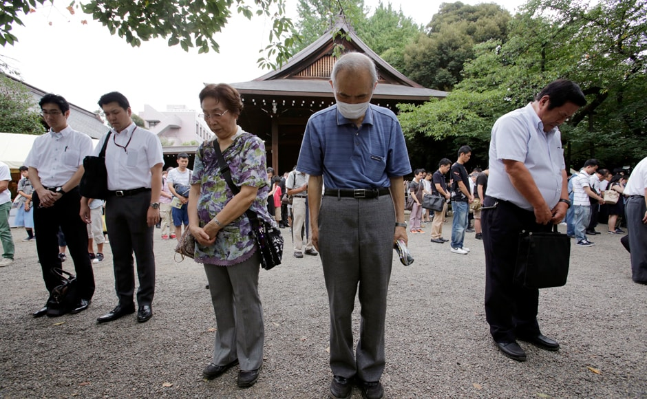 Visitors offer a silent prayer to the ward dead at Yasukuni Shrine in Tokyo Monday, Aug. 15, 2016. Japan marked the 71st anniversary of the end of World War II. APThousands of people, including ageing survivors and relatives of victims, observed a minute's silence at 11.02 am, the exact moment of the blast. Photo: AP