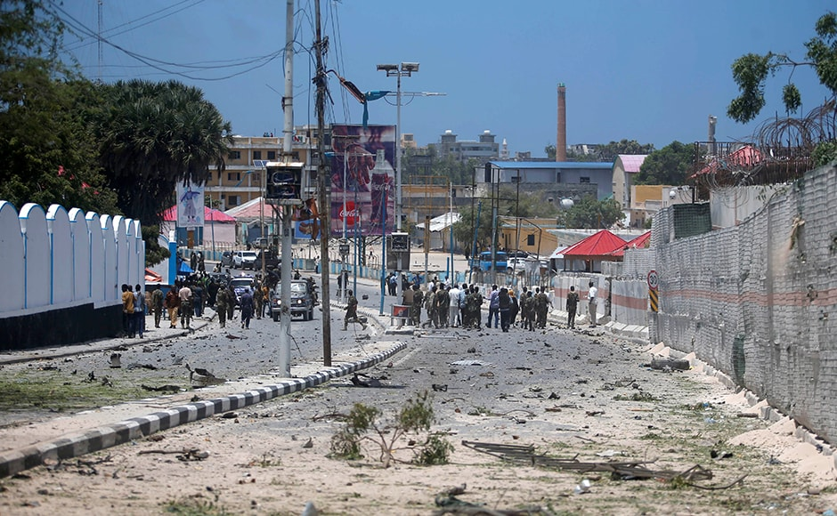 The bomb exploded during a morning traffic jam and the explosion was heard across Mogadishu, and smoke was seen billowing over the area of the presidential compound. A general view of the scene shows Somali government forces securing the street near the scene of a car bomb claimed by al Shabab Islamist militants outside the president's palace. Reuters