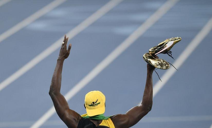 Usain Bolt celebrates winning the men's 100-meter final. AP