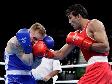 India's Manoj Kumar lands a punch on Lithuania's Evaldas Petrauskas. AP