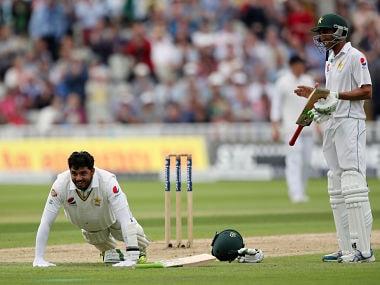Pakistan batsman Azhar Ali celebrates his 100 not out by doing press ups. AP