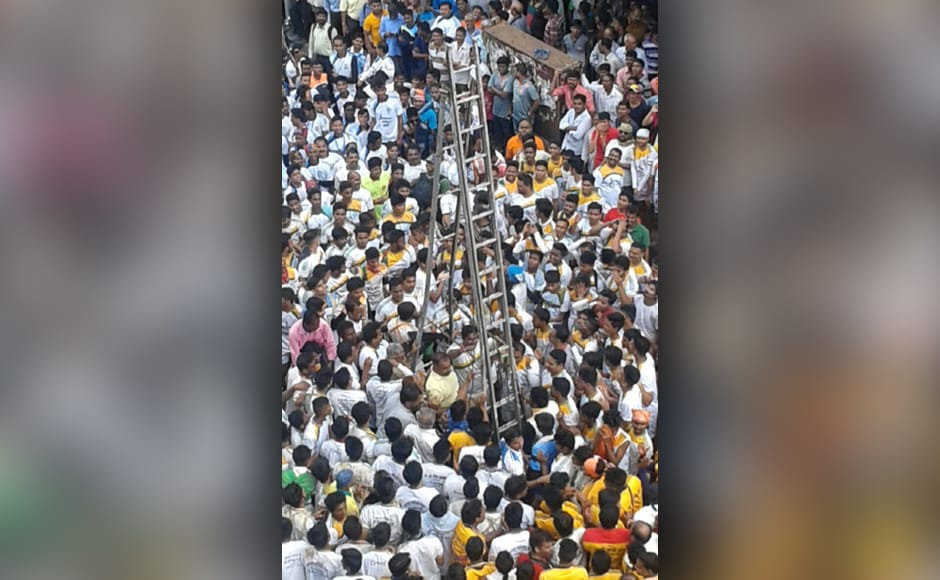 While one Dadar organisation built a 'horizontal' pyramid on the ground and then broke the pot at a height of more than 30 feet, but the Govinda climbed a ladder to break it. Sanjay Sawant