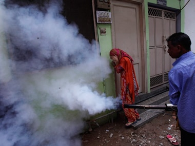 A man tries to use fogging machine to prevent dengue in Delhi. Reuters