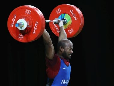 Sathish Kumar Sivalingam lifts during the Men's 77kg weightlifting contest. Getty