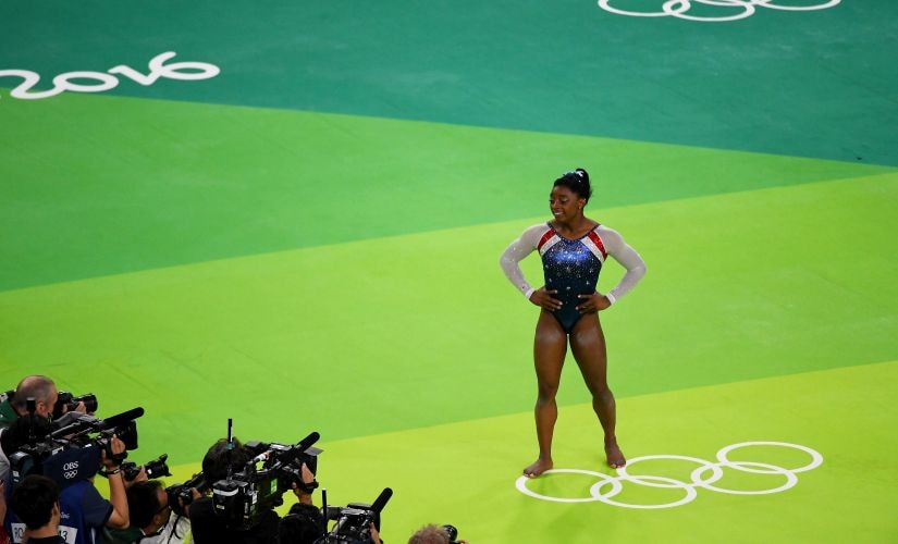 Simone Biles celebrates after winning the gold medal. Getty