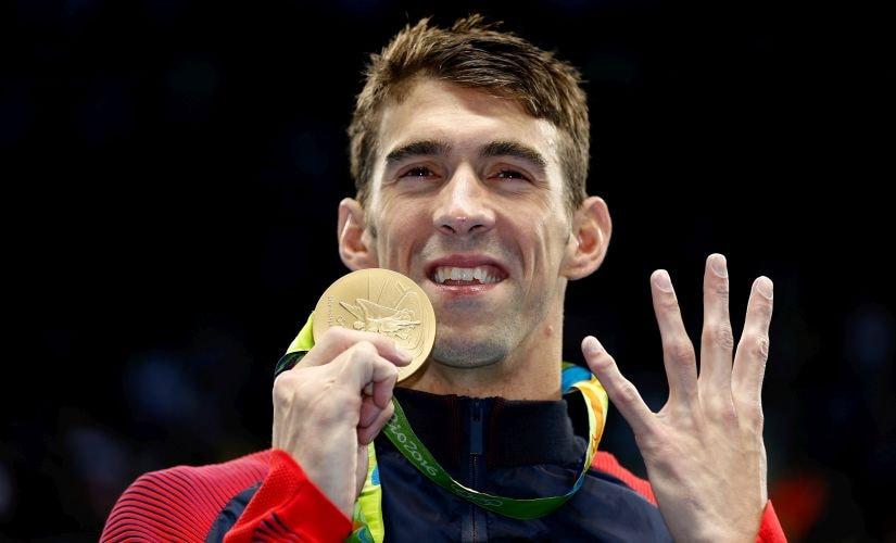Gold medalist Michael Phelps celebrates during the medal ceremony. Getty