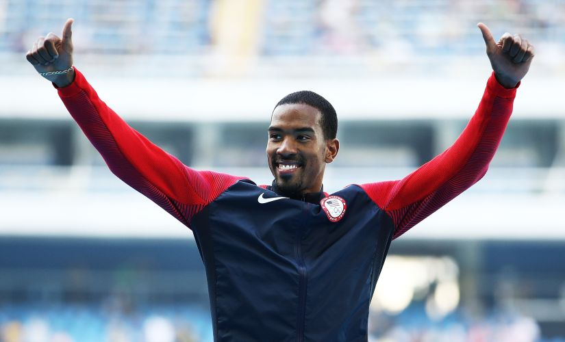 Gold medalist Christian Taylor reacts on the podium during the medal ceremony. Getty