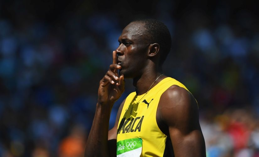 Usain Bolt gestures prior to competing in the Men's 200m Round 1 - Heat 9. Getty