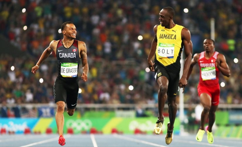 Andre de Grasse and Usain Bolt react as they compete in the Men's 200m Semifinals. Getty