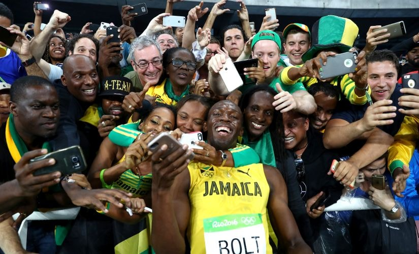 Usain Bolt celebrates with fans after winning the Men's 200m Final. Getty