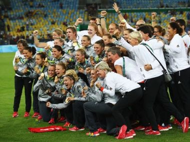 German players celebrate as they receive their medals following victory over Sweden. Getty