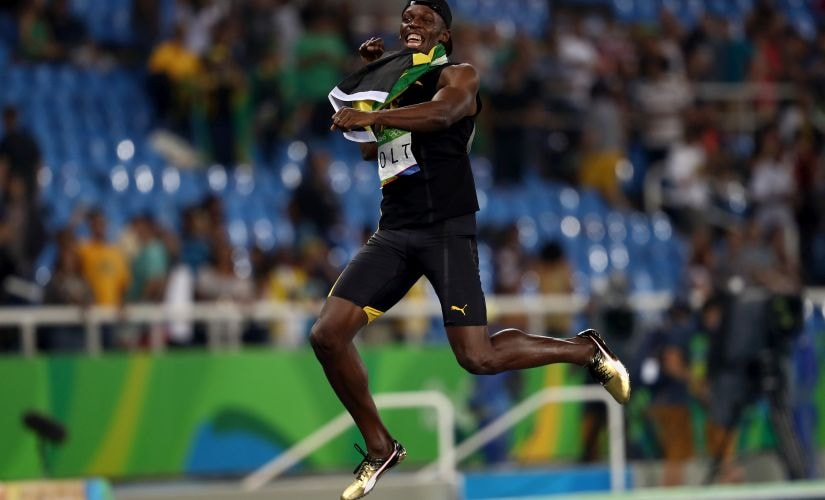 Usain Bolt celebrates winning the Men's 4 x 100m Relay Final. Getty