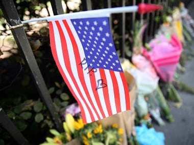 Floral tributes and a Stars and Stripes are seen at the spot in Russell Square where Darlene Horton died following a knife attack, in central London. Reuters