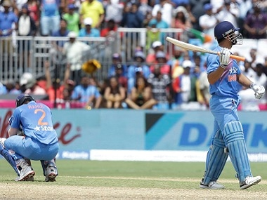 India's Lokesh Rahul (left) and MS Dhoni react after the first T20I. AP