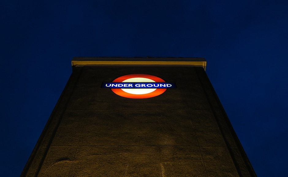 The London underground logo is seen just before dawn at Wanstead underground tube station in London March 3, 2016. REUTERS