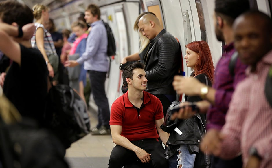 Passengers wait to get on a Night Tube train service at Oxford Circus on the London underground system in London, Britain August 20, 2016. REUTERS