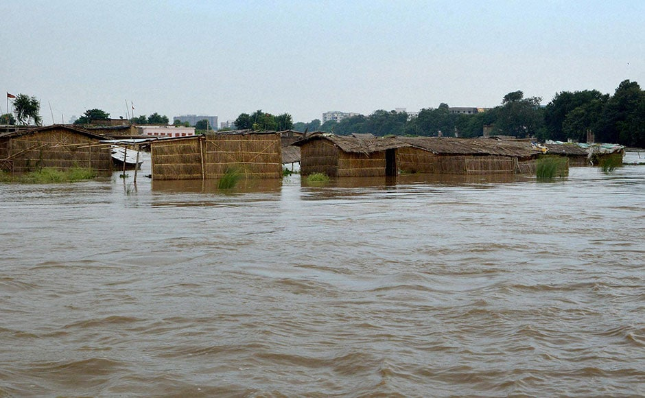 The water level in Ganga river swelled following heavy downpour, threatening inundation of areas close by. Although the flood situation eased, the river remained above danger mark. Photo: PTI