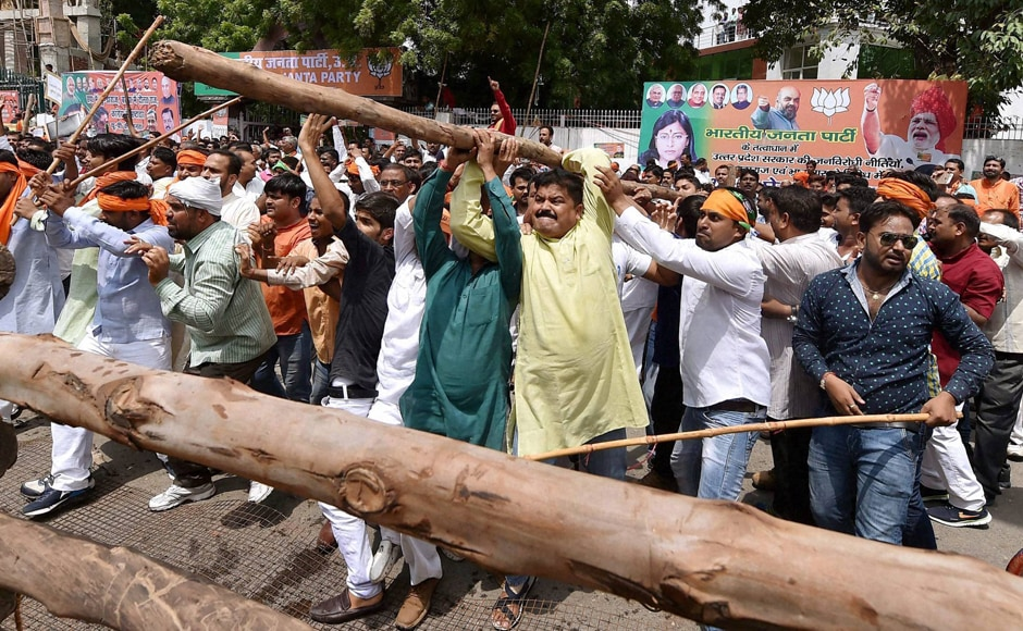 The BJP workers assembled at party headquarters and attempted to march towards Vidhan Bhawan. They broke the barricading and continued to protest. Photo: PTI