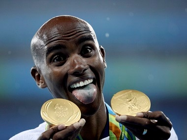 Gold medalist Mo Farah of Britain reacts after adding to Great Britain's medal tally. Reuters
