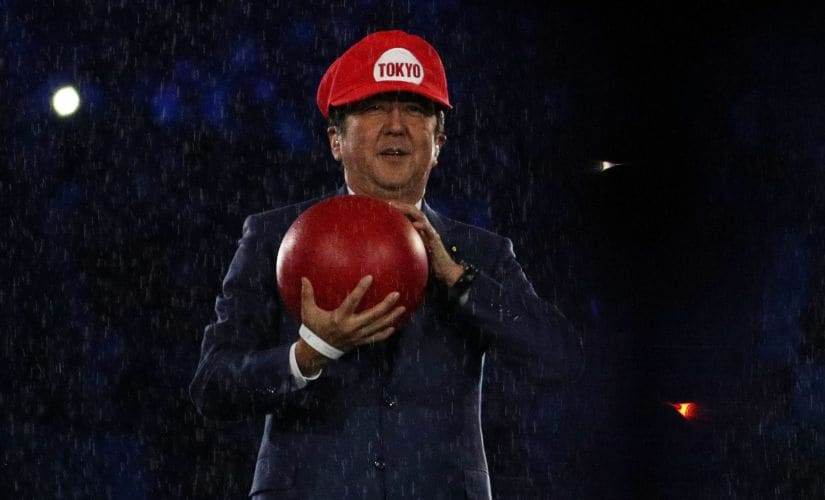 Prime Minister of Japan Shinzo Abe dressed up as Super Mario on stage. Reuters
