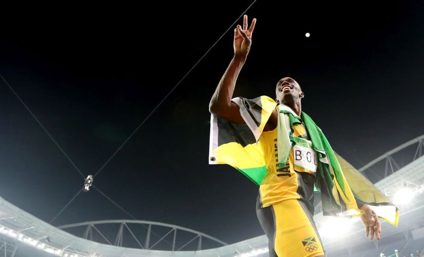 Usain Bolt celebrates winning the gold medal in the men's 4x100-meter relay final. AP