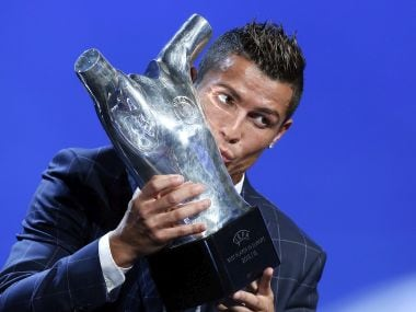 Cristiano Ronaldo kisses his trophy after winning the best player of the year award. AP