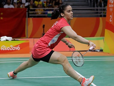 Saina Nehwal returns a shot to Ukrain's Maria Ulitina. AP