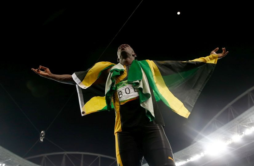 Usain Bolt of Jamaica celebrates winning the Men's 4 x 100m Relay Final. Getty Images