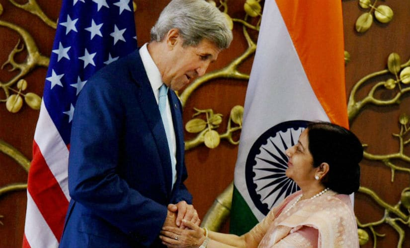 US Secretary of State John Kerry with External Affairs minister Sushma Swaraj. PTI