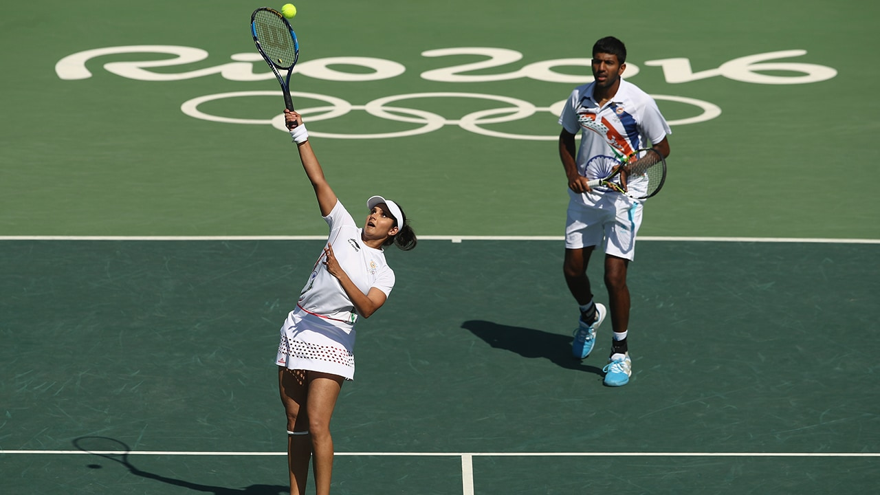 RIO DE JANEIRO, BRAZIL - AUGUST 14: Rohan Bopanna and Sania Mirza of India in action during the mixed doubles bronze medal match against Radek Stepanek and Lucie Hradecka of the Czech Republic on Day 9 of the Rio 2016 Olympic Games at the Olympic Tennis Centre on August 14, 2016 in Rio de Janeiro, Brazil. (Photo by Julian Finney/Getty Images)