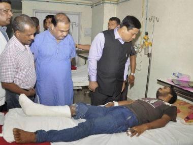 Chief Minister Sarbananda Sonowal meets victims of Kokrajhar attack. PTI